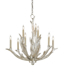 One of Currey & Company's many chandeliers, the Haywood, that glows with light
