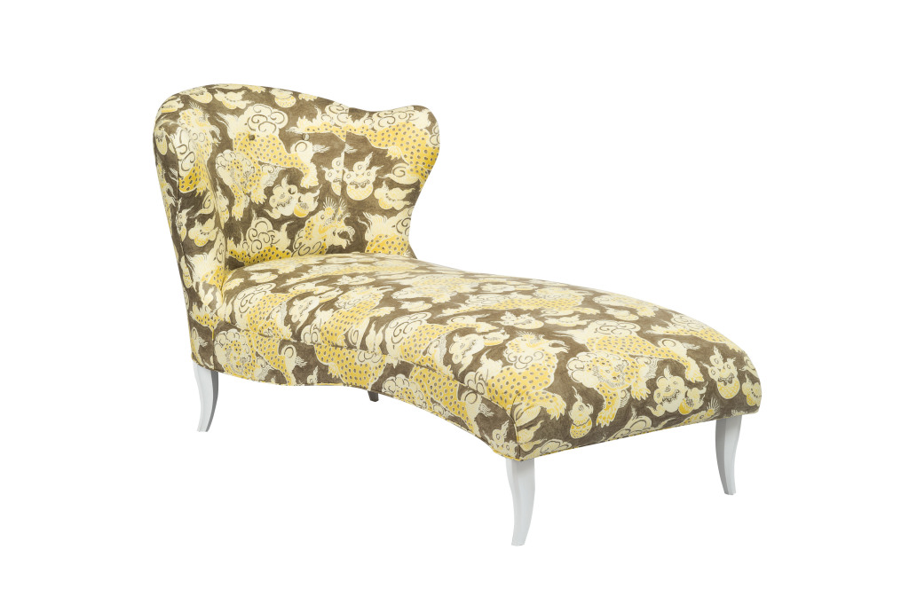 An undulant chaise by Currey & Company