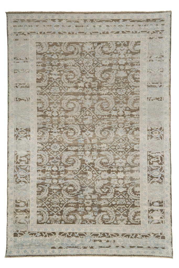 Though this rug looks ancient, is is a new carpet made to look old by our weavers