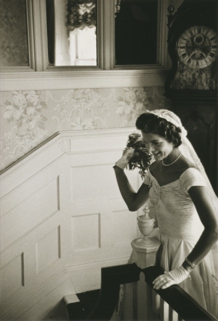 Jacqueline Bouvier readies to toss her bouquet as the new Mrs. Kennedy