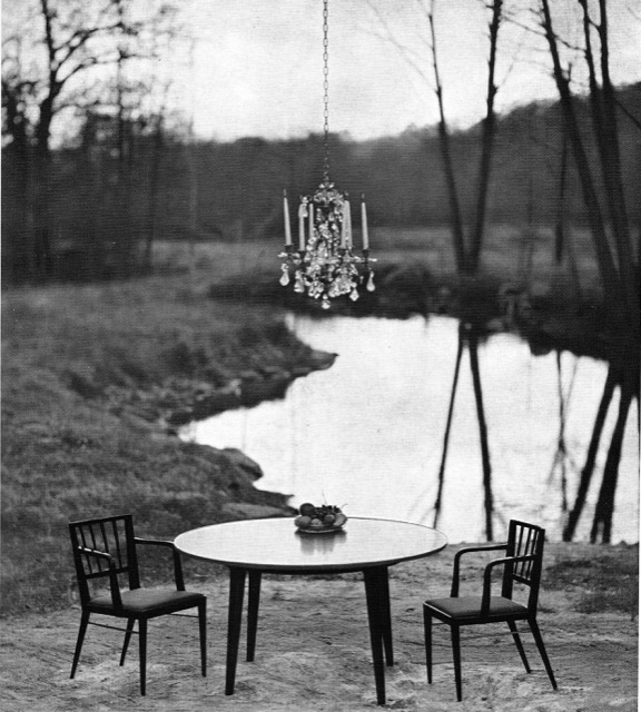 A chandelier floats above a dining set by Dunbar