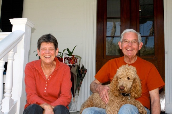 Robert and Suzy Currey with their Standard Poodle Rives.