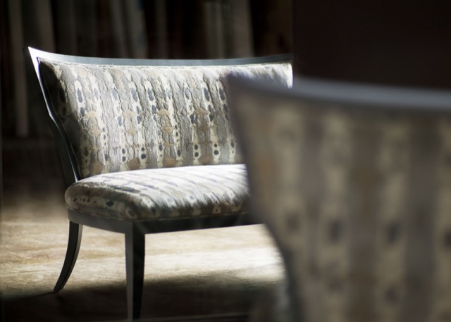A moody shot of a Currey and Company settee
