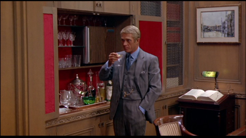Steve McQueen as Thomas Crown, his character a master at setting a mood