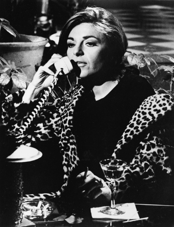 Anne Bancroft in leopard print that fits her femme fatale character so perfectly