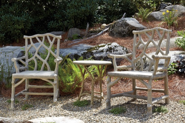 Woodland arm chair and Hidcote accent table in a garden setting