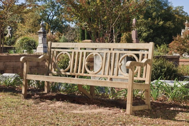 Leagrave bench, faux bois by Currey and Company gracing the garden