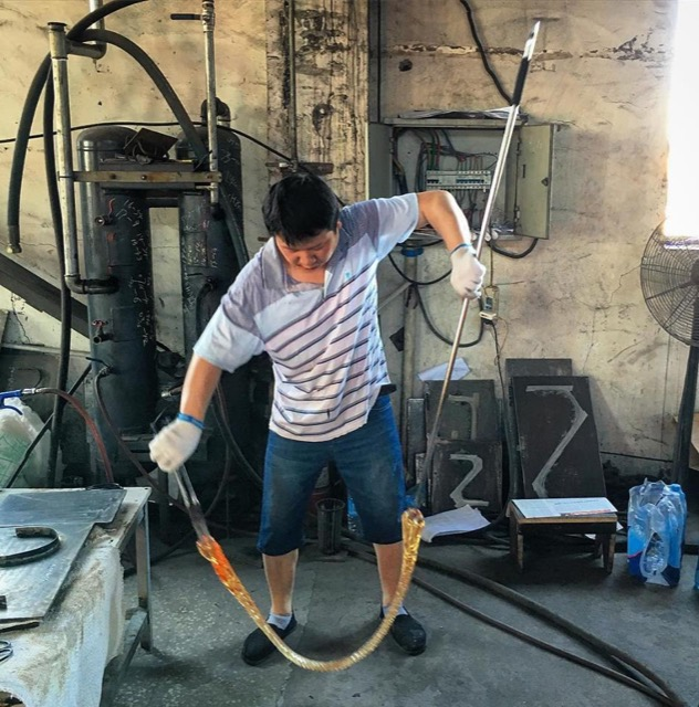 Glassblower Handling Glass