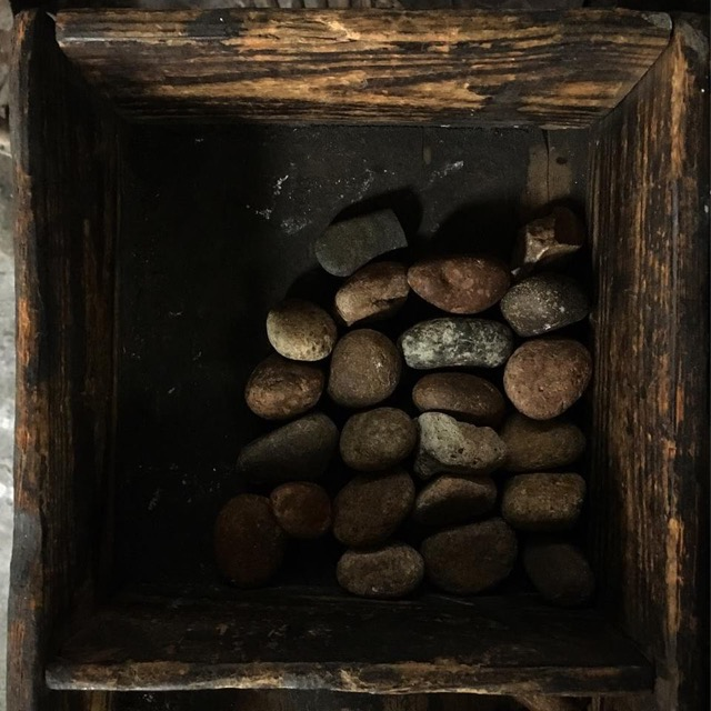 Old box with stones