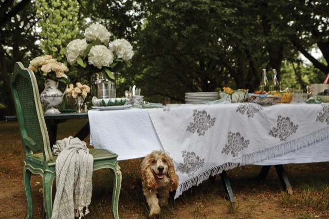 a lovely outdoor table set for entertaining in the book Living Floral