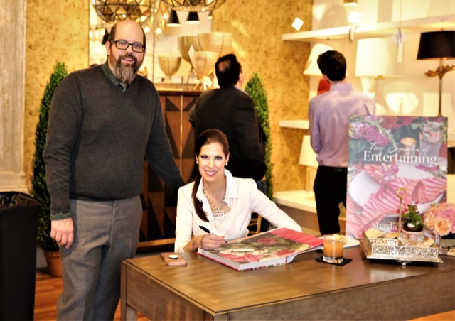 Brownlee with Shayla Copas signing her book Four Seasons of Entertaining.