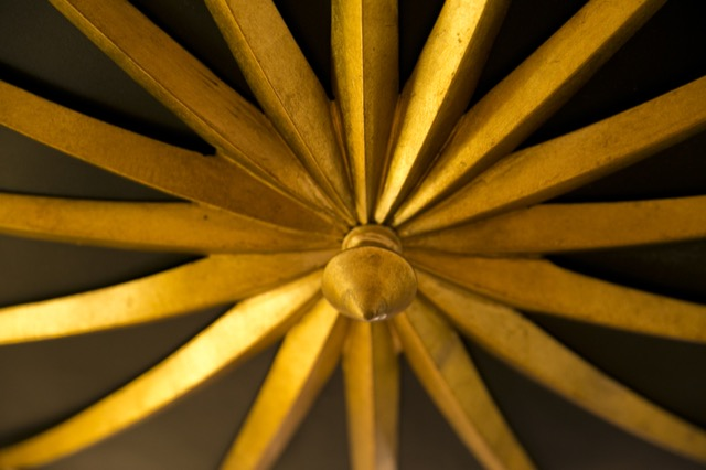 Detail shot of a luminous Currey & Company gold finish