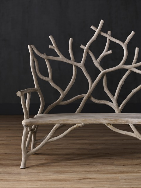 The Elwynn bench by Currey & Company in a moody beauty shot