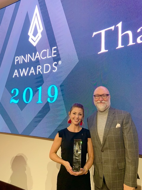 Aimee Kurzner, holding her Pinnacle Award for the Currey & Company Kallista writing desk, with our VP/Creative Director Cecil Adams.
