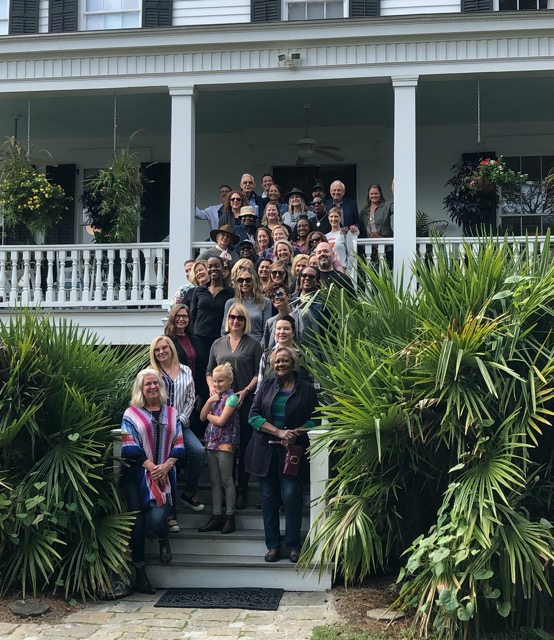Attendees of the Designer Experience on the front steps of the Currey home at Elm Street Gardens in Sparta where they had a feast for the senses.