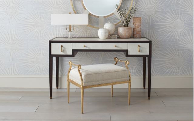 The Evie Shagreen Desk is the centerpiece of this vignette that illustrates our products in Cecil's 20's Contemporary trend story. Also in the mix are the Genevieve Shimmer Gold Ottoman, the Camille Round Mirror, the Chiara Table Lamp, and a selection of our accessories.