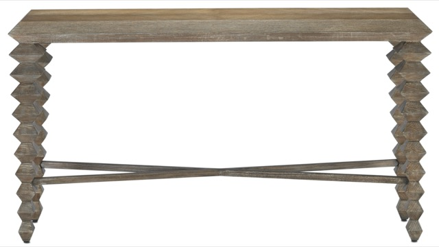 The Currey & Company Saranya Pepper Console Table is one of the designer's favorites.