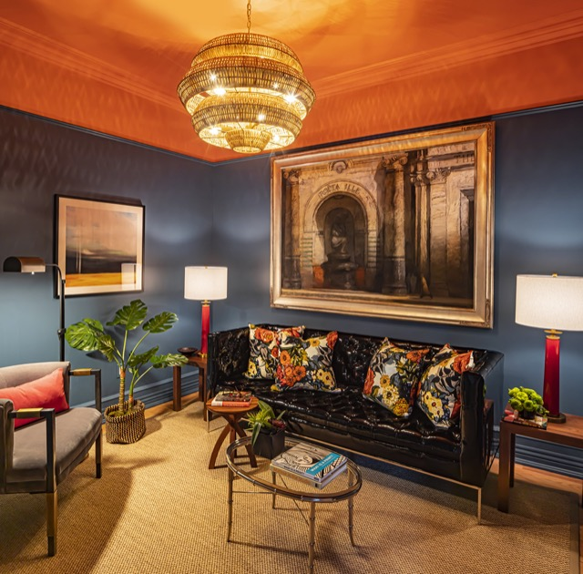 "Courtney chose one of our Antibes chandeliers and our Rhyme Red table lamps for this den. ""The red of the lamps served as a wonderful pop of color against the blue walls and the Antibes dazzles in the small space,"" Courtney explains. ""It is a glamorous and unexpected mix."""