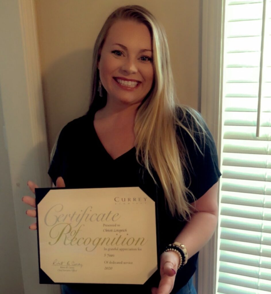 Christi Lotspeich, our Accounts Payable and Service Operations, receives her service award for five years at Currey & Company.