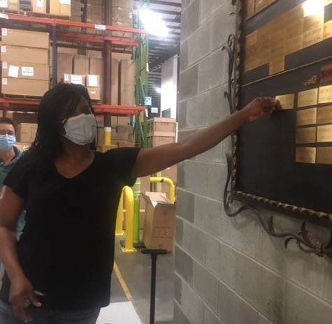 Renita Young, our Parts Specialist, receives her service award for five years at Currey & Company.