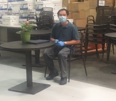 Nghia Nguyen, a Product Finishing Specialist, receives his service award for 15 years at Currey & Company.