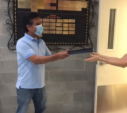 Miguel Sanchez, our Senior Project Engineer, receives his service award for 25 years at Currey & Company.