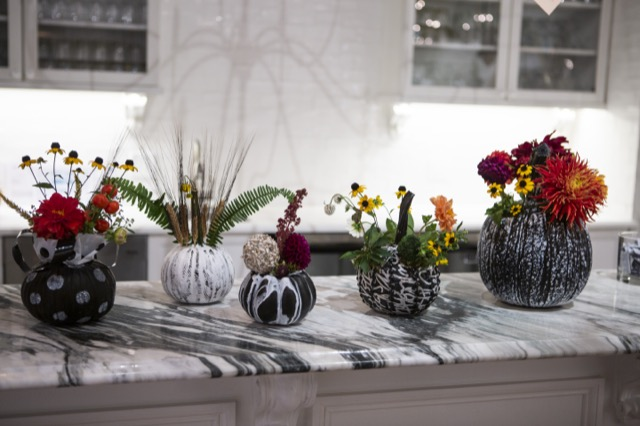 Vases filled with flowers from the Currey & Company showroom during High Point Market