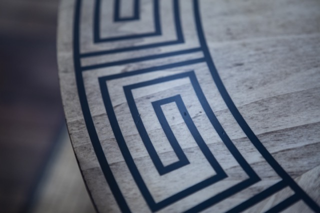 A detail shot of the Greek Key inlay on the Artemis Entry/Dining Table by Barry Goralnick for Currey & Company.