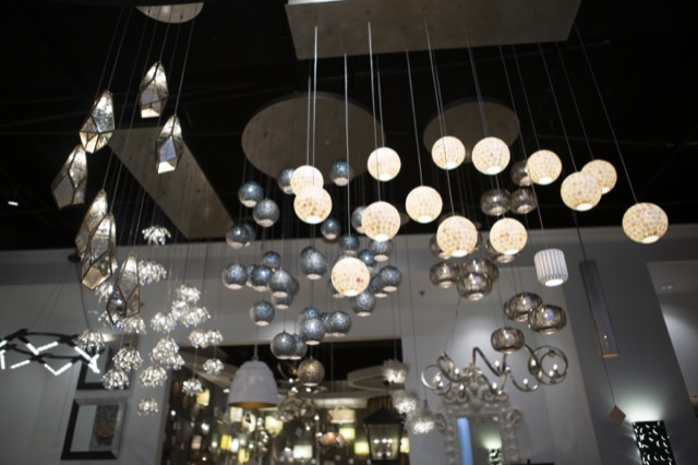Multi-Drop Pendants in the Currey & Company showroom for High Point Market.