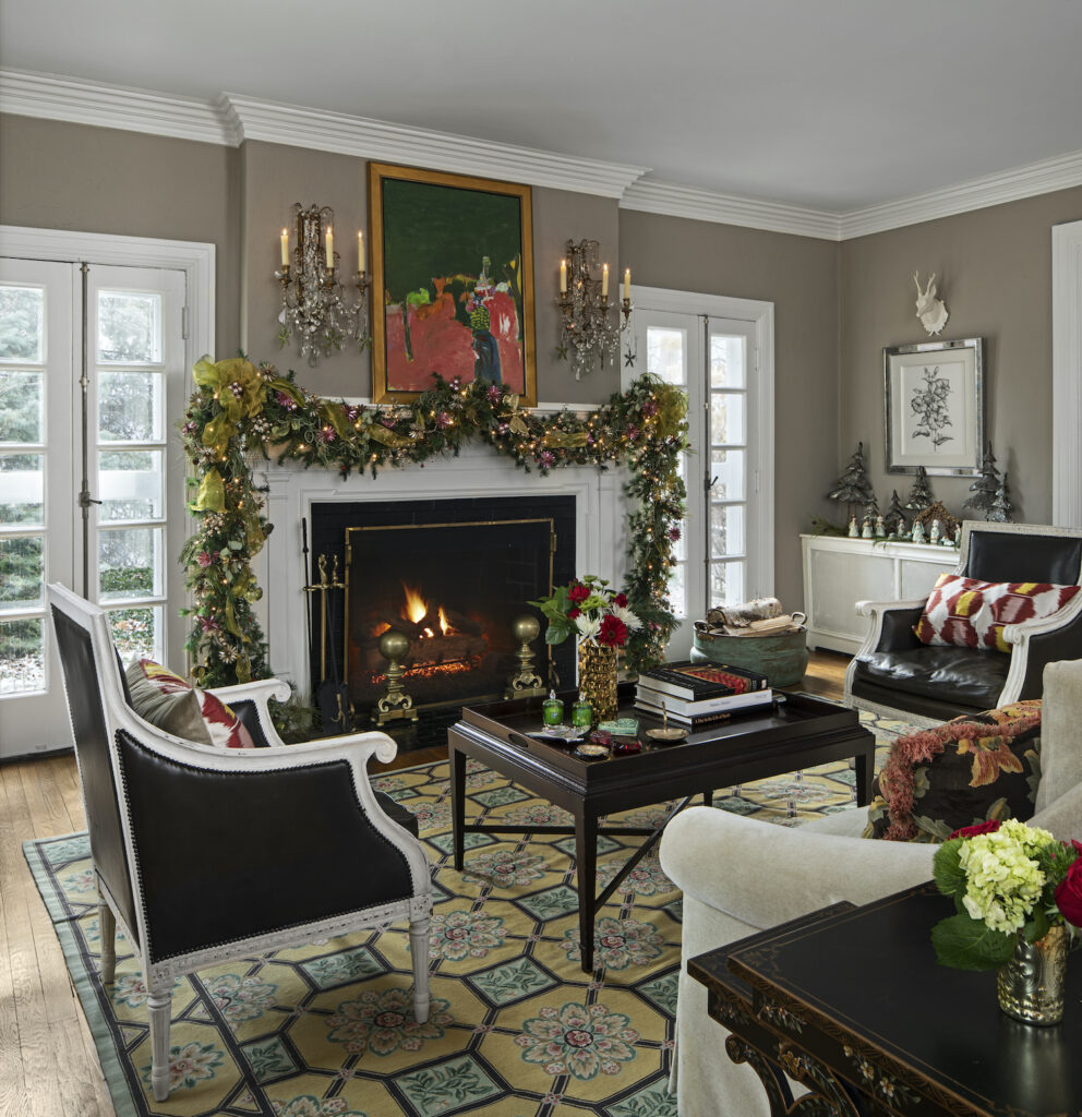 A roaring fireplace is one of Nicole's winter rituals, this one draped in garland with a festive holiday style. Photo courtesy Beth Singer.
