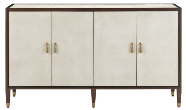 The Currey & Company Evie Shagreen Credenza, an ivory cabinet covered in shagreen with brass pulls.