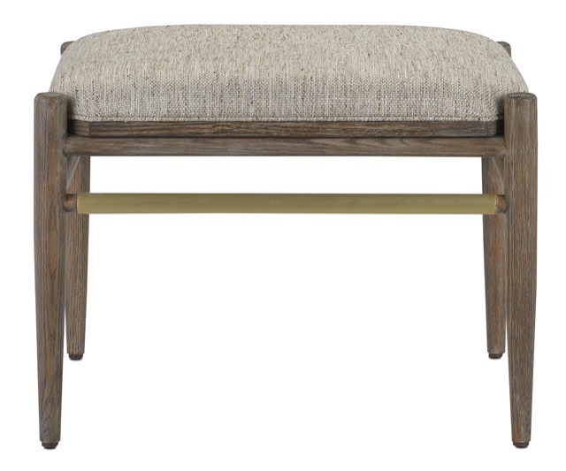 The Visby Calcutta Pepper Ottoman by Currey & Company has a top that flips from upholstery to tabletop.