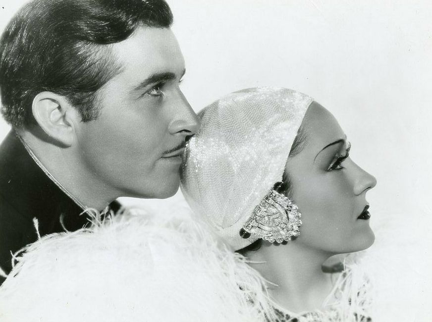 Gloria Swanson and John Boles in 1934 in Music in the Air. Image in public domain.