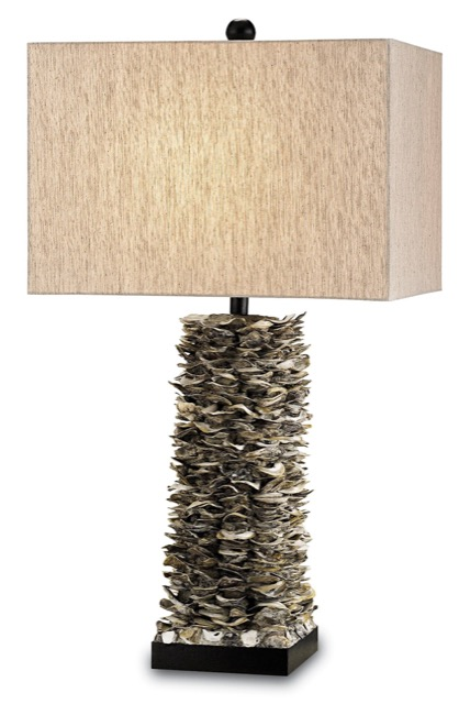 The Villamare Table Lamp by Currey & Company has a body made of stacked oyster shells.