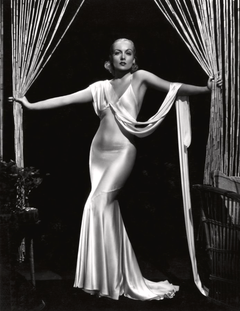 Carole Lombard, displaying all of her charm, is the epitome of glamour. Image in public domain.