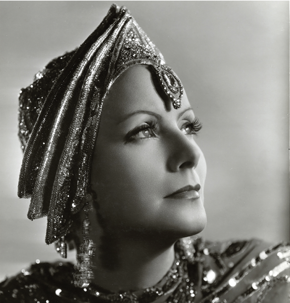 Greta Garbo in 1931 in Mata Hari in a headdress designed by Wizard of Oz costumer Adrian Adolph Greenberg. Image public domain.