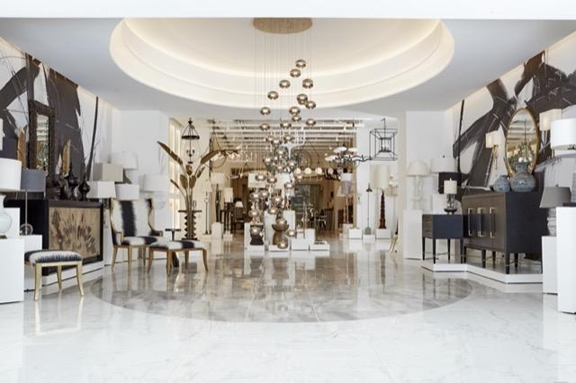 Currey & Company Multi-drop chandeliers greet visitors.