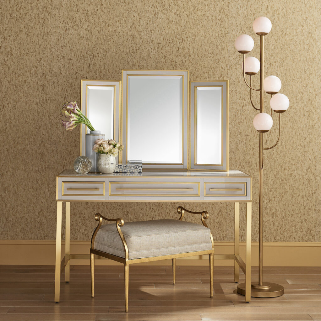 The new Arden Ivory Vanity and mirror shown with the Genevieve Gold Ottoman, both pieces bestsellers during High Point Market.
