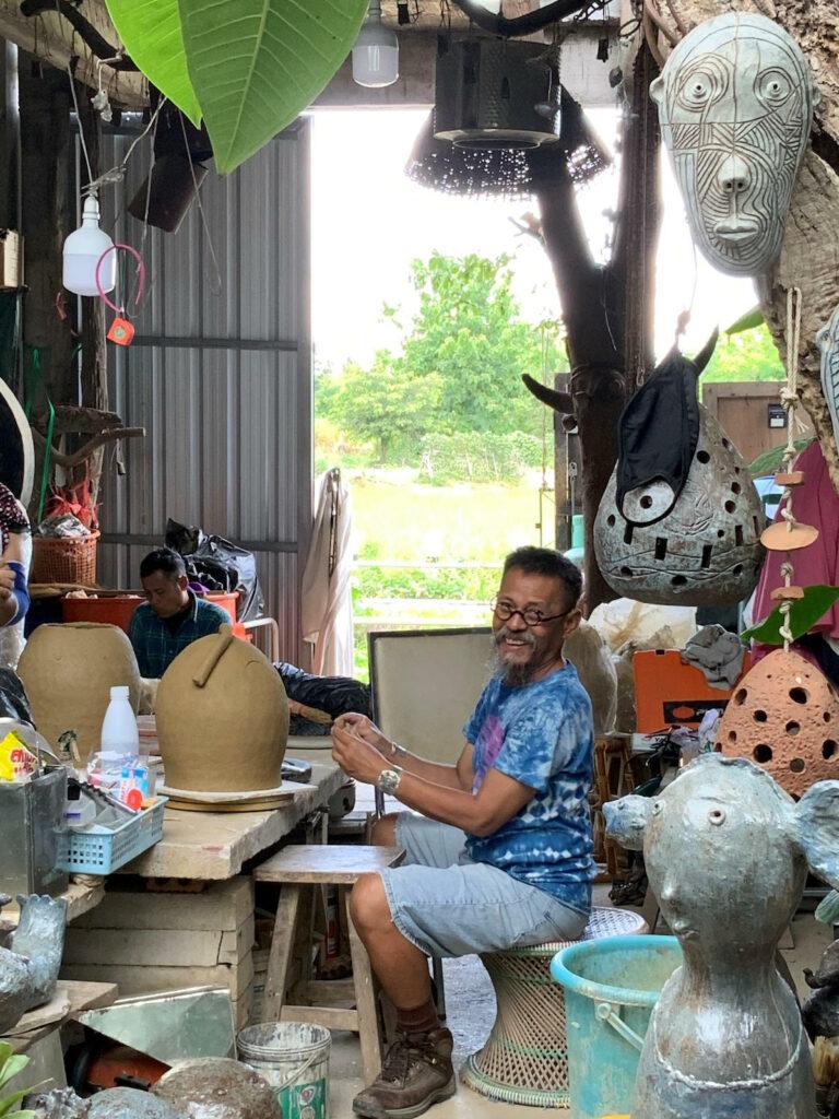 Arjan Deng in his studio making sculptures.