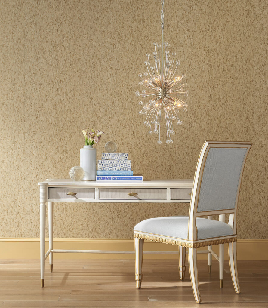 The Aster Desk by Currey & Company, a bestseller at High Point Market, shown with the Ines Mist Ivory Chair.