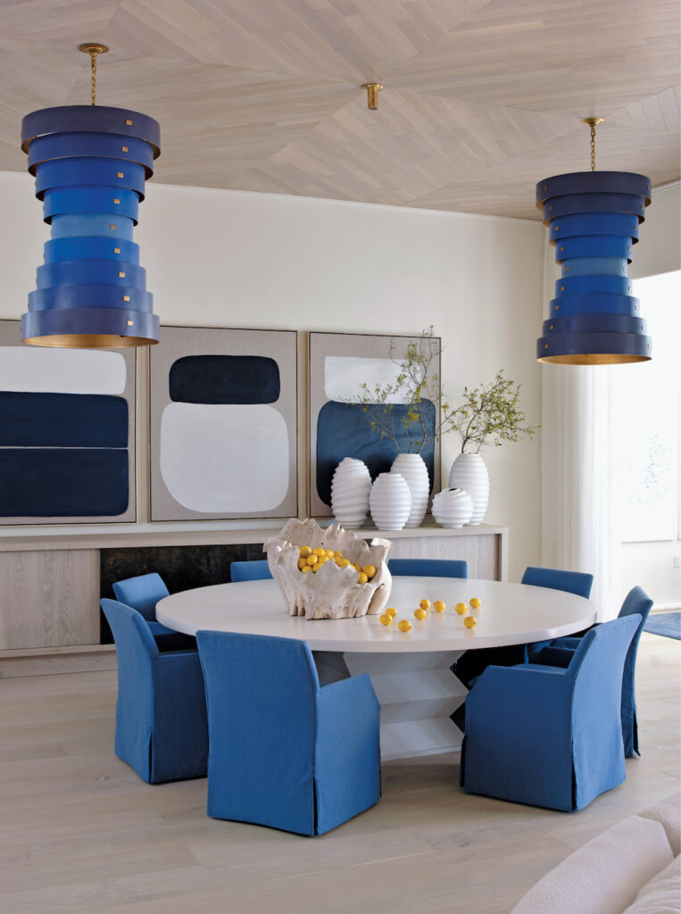 """A pair of our Graduation Chandeliers hang in a contemporary home featured in the chapter """"Beach Beauty."""" Image credit: Mali Azima."""