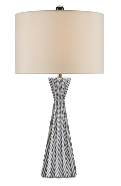 The Currey & Company Fabienne Table Lamp is made of porcelain with a black and white pattern on its surface.