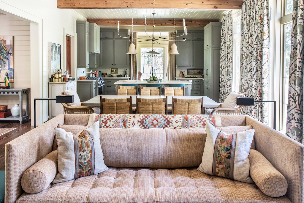 The Saxon Silver Chandelier hangs above the dining room table and our Pharrell Pendants illuminate the kitchen island in the Flower Showhouse.
