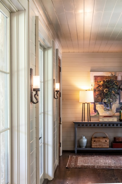 A pair of our Avalon Wall Sconces illuminate the entryway to the Flower Showhouse.