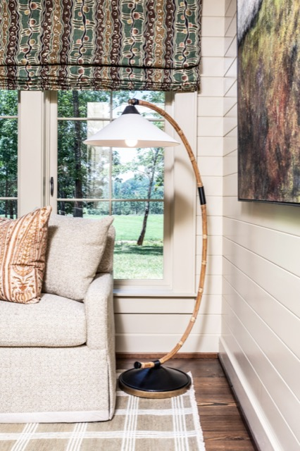 The Lisbon Floor Lamp is sitting pretty in a corner of the living room.