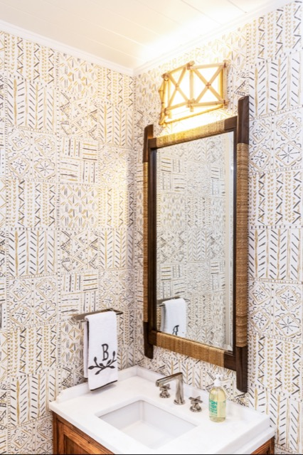Our Kingali Wall Sconce shines brightly above the mirror in the powder room.