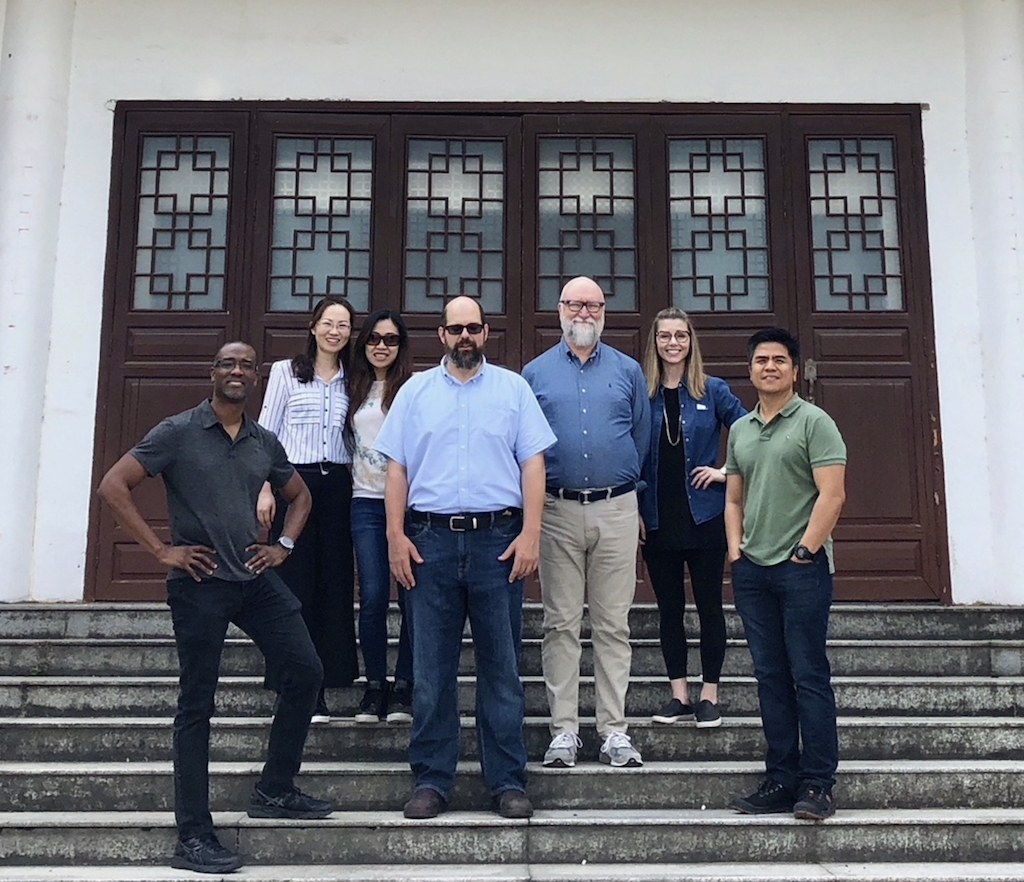 Brownlee with the Currey & Company design team in China before supply chain challenges were caused by the pandemic.
