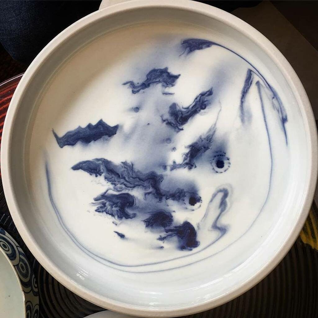 A photo of a plate painted by Chinese artisans.