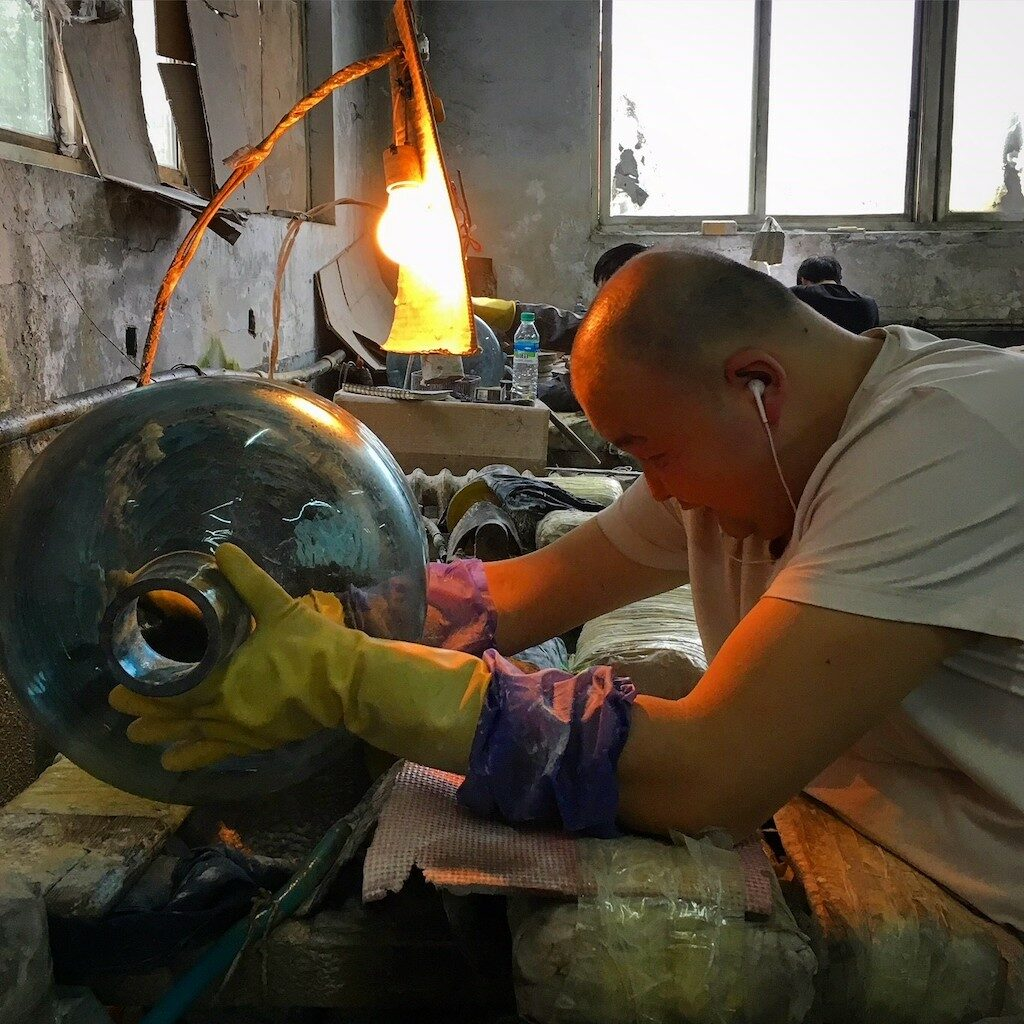 Brownlee photographed this artisan working with glass.