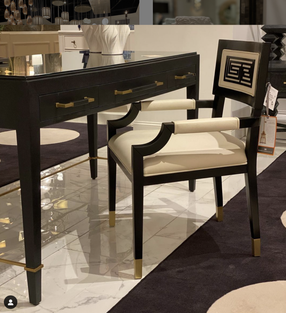 The Verona Black Large Desk in the High Point showroom, posted to Instagram by @curreycolatinamerica, paired with Barry Goralnick's Artemis Leather Chair.